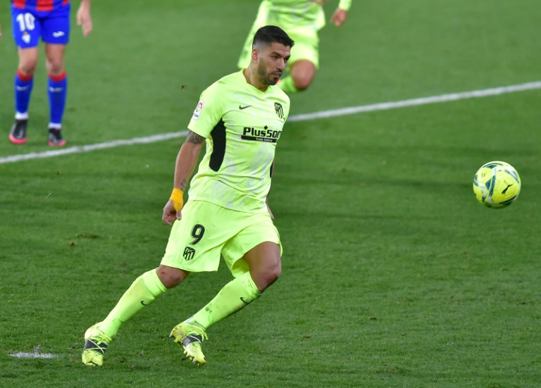 Suarez double fires Atletico seven points clear. AFP