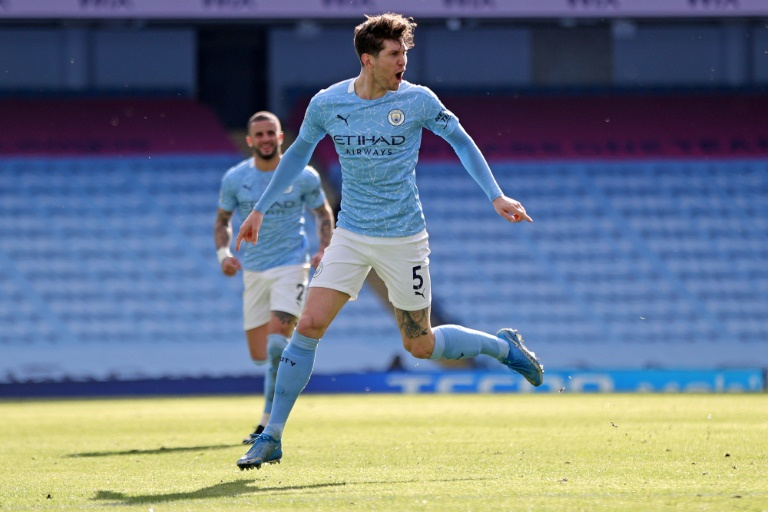 John Stones got the decisive goal as Man City won their 20th game in a row. AFP