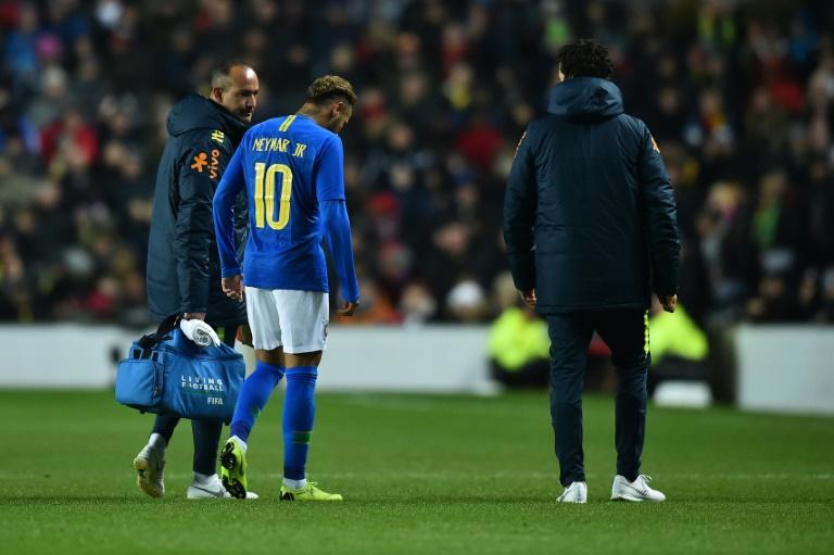 Neymar injured as Brazil beat Cameroon.
