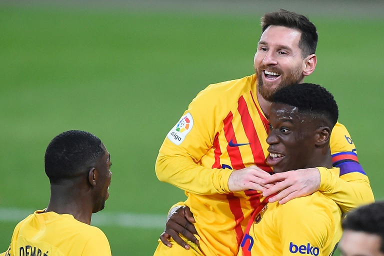 Ilaix Moriba (R) got his first La Liga goal as Barcelona won 0-2 at Osasuna. AFP