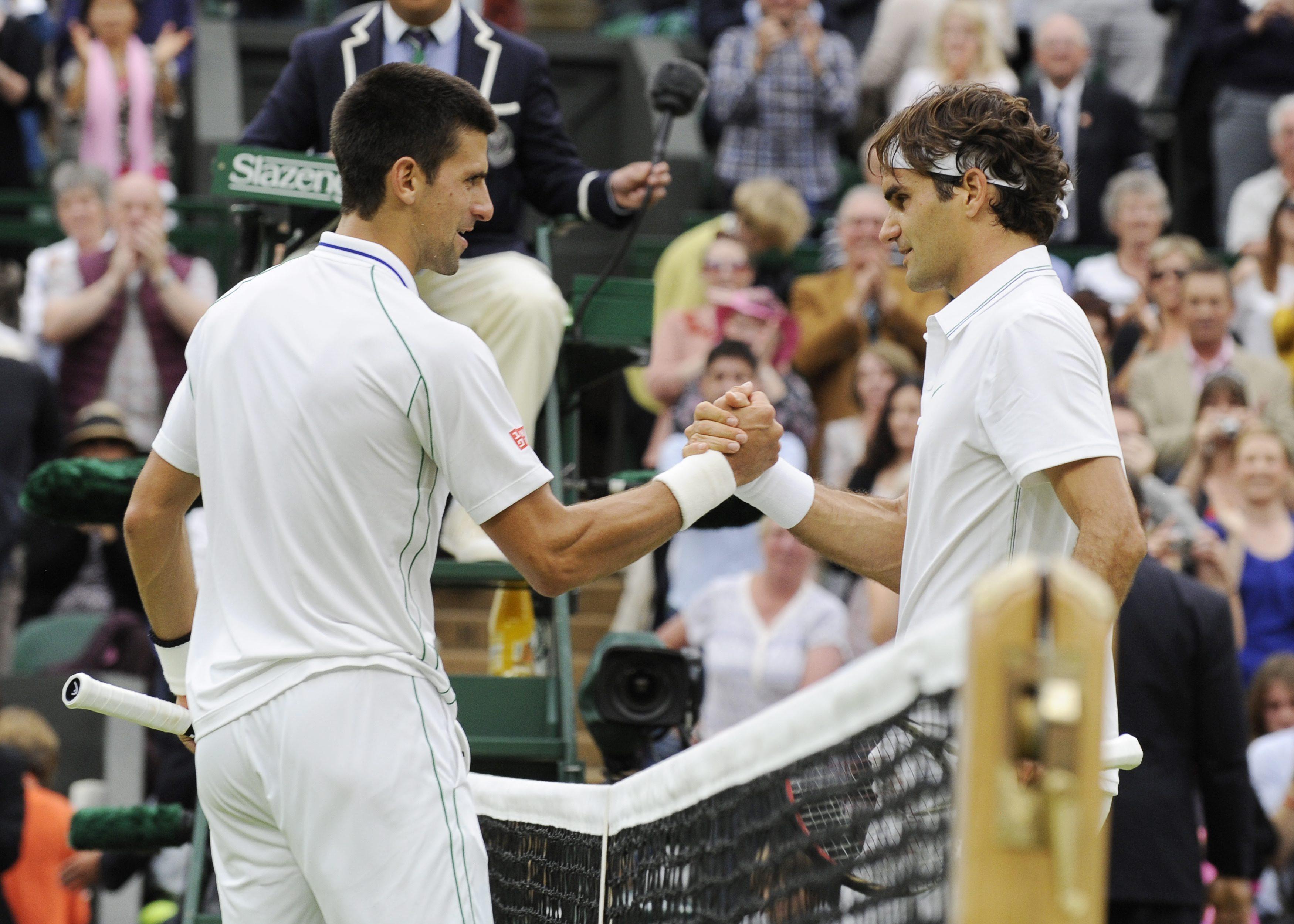 Federer (d) y Djokovic (i), del equipo Europa, se enfrentarán contra el estadounidense Jack Sock y el surafricano Kevin Anderson (Mundo), durante el  plato fuerte de la Laver Cup, en la cancha habitual de los Chicago Bulls. EFE/Archivo